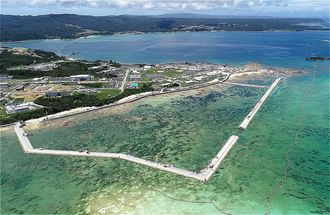 新基地建設が進むキャンプ・シュワブ沿岸。海域を護岸で囲む工事が進む=6月29日、名護市辺野古の米軍キャンプ・シュワブ(小型無人機で撮影)