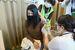 津堅島で行われた新型コロナウイルスワクチンの住民への接種=15日午後0時34分、沖縄県うるま市勝連津堅の津堅小中学校(代表撮影)