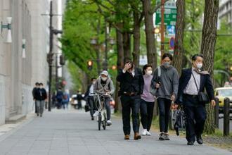 聖火リレーが行われる予定だった大阪市の御堂筋=14日午後