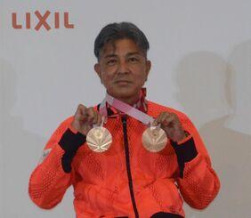 (資料写真)メダル獲得から一夜明けた会見で喜びを語る上与那原寛和=2021年8月31日、東京都中央区・ホテルマリナーズコート東京