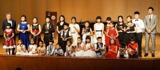 沖縄からも6人が参加した第1回台日国際児童音楽コンクール優勝コンサート=6月18日、台北市内の台湾師範大学付属中学校演奏ホール(県台北事務所提供)