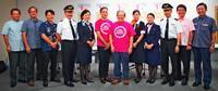 乳がん検診を空でもPR 沖縄のJALグループ「ピンクリボン」活動に協賛