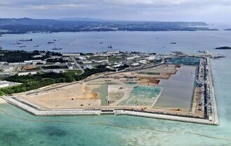 米軍普天間飛行場の移設先として、米軍キャンプ・シュワブ沿岸で進む土砂埋め立て工事=2020年12月、沖縄県名護市辺野古(小型無人機から)