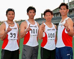 男子A400メートルリレーで、42秒41の35歳以上のアジア新記録を樹立したNEXT ONEの(左から)大城友喜、山内昌也、金城研、譜久里武=県総合運動公園陸上競技場