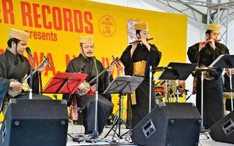ビートルズの曲と琉球楽器が融合した奏琉楽団「琉球ビートルズ」の演奏=那覇市・パレットくもじ