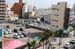 ホテル建設が予定されている國映館の跡地(右)と隣接する駐車場=那覇市松尾の国際通り(2014年6月撮影)