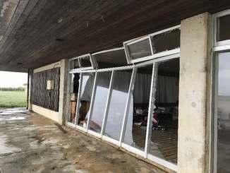 突風で大きく割れた伊江島空港事務所の窓ガラス=16日、伊江村の同所(提供)