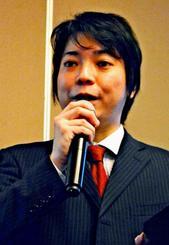 ベトナム国営企業の合併・買収による同国進出を勧める嘉数昇吾氏=7日、ベトナム・ホーチミン市・ルネッサンスリバーサイドホテルサイゴン