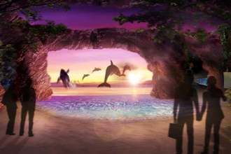 イルカが跳ねる海を波打ち際から眺められる空間のイメージ(DMM.com提供)