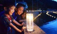 キャンドルゆらゆら、幻想的に 沖縄・塩屋湾を彩る4300本
