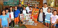 タコライス食べたら学校に本が増えた 沖縄・金武町