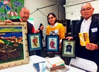 北米沖縄県人会に寄贈された故・大嶺政寛画伯の絵。左はエディー神谷県人会会長=米ロサンゼルスの同県人会館