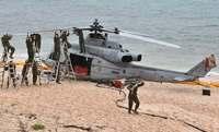 伊計島ヘリ不時着:米軍、事故機をつり下げ空輸へ 天候次第で8日にも