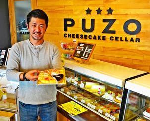 沖縄発のチーズケーキで販路拡大を狙うトランクの野間謙策社長=那覇市・PUZO小禄ラボ店