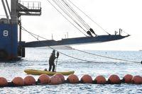 市民がカヌー12艇、船2隻で抗議 一時拘束