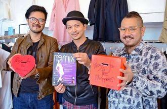 募金箱やイベントのチラシを手にする(左から)嘉数義成さん、ミランダさん、新里清明さん=宜野湾市喜友名・LEQUIO
