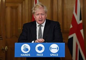 外出制限について記者会見で表明する英国のボリス・ジョンソン首相=31日、ロンドン(AP=共同)