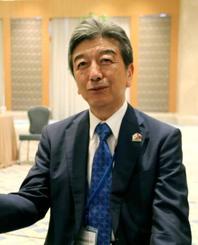 インタビューに応じる経団連副会長の山西健一郎氏(共同)