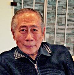 「これまでの経験を沖縄に残したい」と語るマキノ正幸氏=北谷町