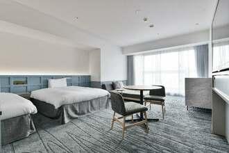 2020年3月に開業するベッセルホテルズ初のリゾートホテル「レクー沖縄北谷スパ&リゾート」の客室のイメージ図(ベッセルホテル開発提供)