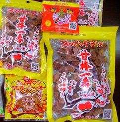上間菓子店が開発した「スッパイマン」シリーズの商品