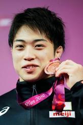 男子フリー61キロ級で銅メダルを獲得した藤田雄大=西安(共同)