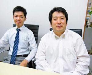沖縄を拠点にクラウドサービス事業に参入するビジネスラリアートの中西俊之社長(右)とBRクラウド社の大城純一取締役=10日、那覇市久茂地