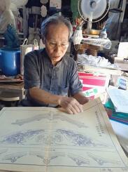 首里城の基本・実施設計を担当し龍柱などを制作した西村貞雄さん=2日、糸満市武富のアトリエ