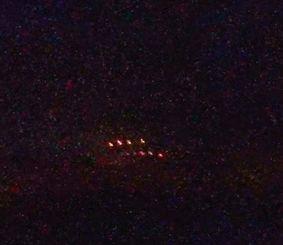恩納村の前兼久漁港から読谷村の残波岬方面に見えた光=12日午後9時24分(古波蔵瑞樹さん提供)