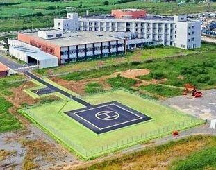 県立八重山病院の隣接地で整備が進められ、11日から運用が始まる急患搬送用の暫定ヘリポート(県提供)