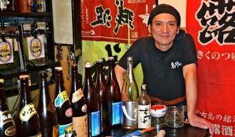 「復興のためには街を明るくしないと」と語る砂川大輔さん=19日、熊本市中央区下通・居酒屋「島うた大ちゃん」