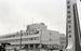 復帰記念式典と「式典粉砕」。記念式典会場の那覇市民会館向いの琉大保健学部には式典粉砕の横断幕=1972年5月15日