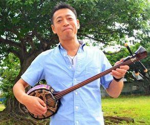「いずれは沖縄で生活したい」と話す小平浩一さん=嘉手納町水釜・西浜区コミュニティーセンター
