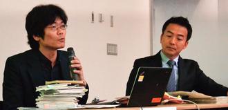 取材を振り返る沖縄タイムスの堀川幸太郎記者(左)ら=15日、横浜市・日本新聞博物館