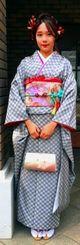 祖母手織りの南風原花織で成人式に出席した岸本絹さん=8日、神奈川県大和市