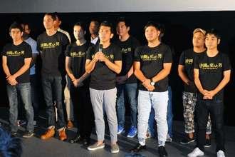 映画「沖縄を変えた男」の舞台あいさつをするガレッジセールのゴリさん(中央)ら=25日、那覇市おもろまち・シネマQ