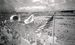 聖火台に火がともり、日の丸、五輪旗、星条旗のひるがえった奥武山陸上競技場=1964年9月7日、那覇市