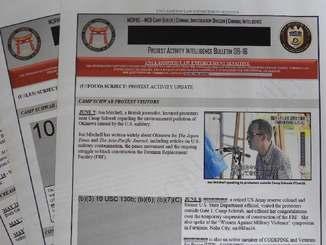 米軍捜査当局による抗議行動の日報。情報公開を求めたジョン・ミッチェル本紙特約通信員の写真もテレビニュースから転用されている